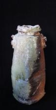 k. vase 9 1/2 in x 4 in