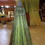 Detail of long plait kitchen broom