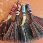 Rooster tail brooms with a herringbone twisted plait