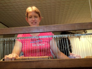 Jeanette's weaving a rug on her big loom