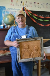 Dan with a relief carving